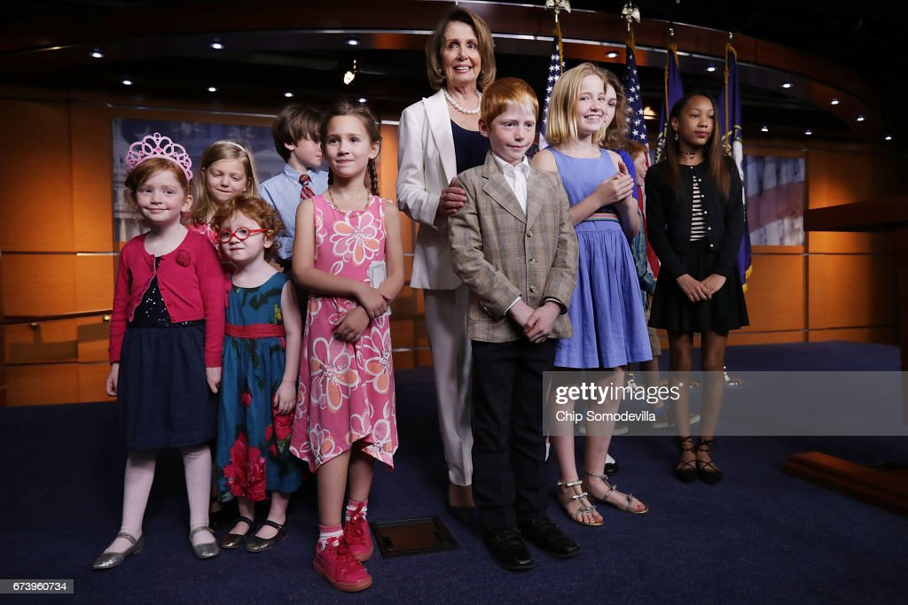 House Minority Leader Nancy Pelosi (D-CA) poses for photographs with journalists' children at the conclusion of her weekly news conference at the U.S. Capitol Visitors Center April 27, 2017 in Washington, DC. Thursday was national Take Our Daughters and Sons to Work Day and many journalists brought their children to the U.S. Capitol. Pelosi gave President Donald Trump a letter grade for his performance as he approaches his 100th day in office.