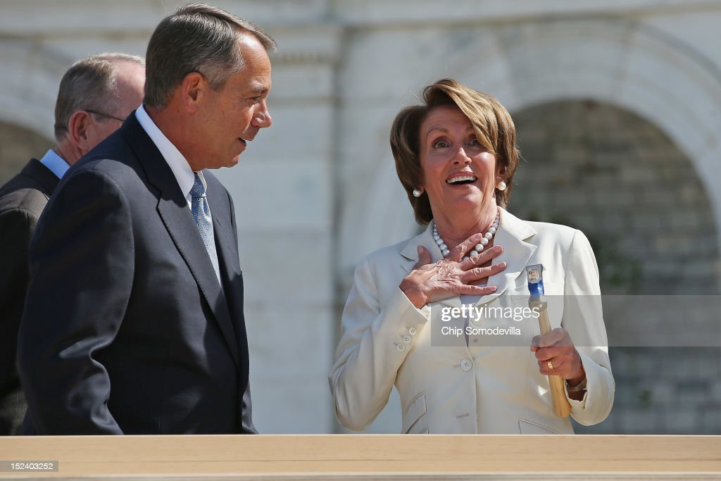 House Minority Leader <a gi-track='captionPersonalityLinkClicked' href=/galleries/search?phrase=Nancy+Pelosi&family=editorial&specificpeople=169883 ng-click='$event.stopPropagation()'>Nancy Pelosi</a> (D-CA) (R) reacts after Speaker of the House <a gi-track='captionPersonalityLinkClicked' href=/galleries/search?phrase=John+Boehner&family=editorial&specificpeople=274752 ng-click='$event.stopPropagation()'>John Boehner</a> finishes driving her nail with one stroke during the 'First Nail' ceremony, signifying the start of construction of the 2013 Inaugural Platform on the West Front of the U.S. Capitol September 20, 2012 in Washington, DC. The winner of the November 6 presidential election will be sworn in on the platform on January 21, 2013.