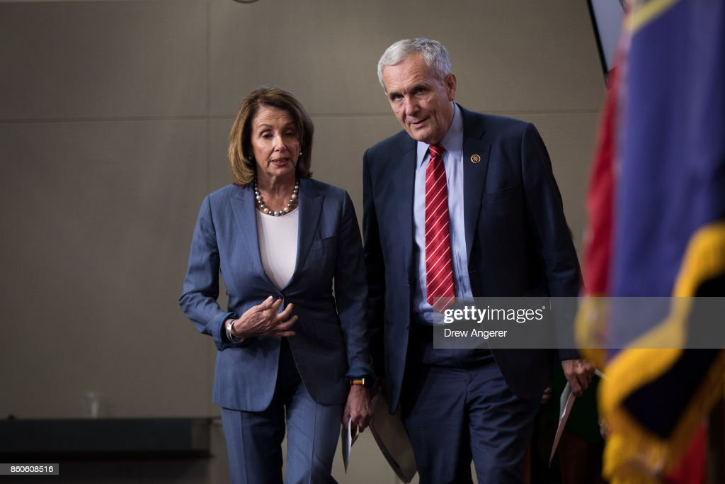 House Minority Leader Nancy Pelosi (D-CA) talks with Rep. Lloyd Doggett (D-TX) as they arrive for a news conference on Republican plans to end the state and local tax deduction, on Capitol Hill, October 12, 2017 in Washington, DC. The Democrats called on Congressional Republicans to hold open and public hearings on their plans for tax reform.