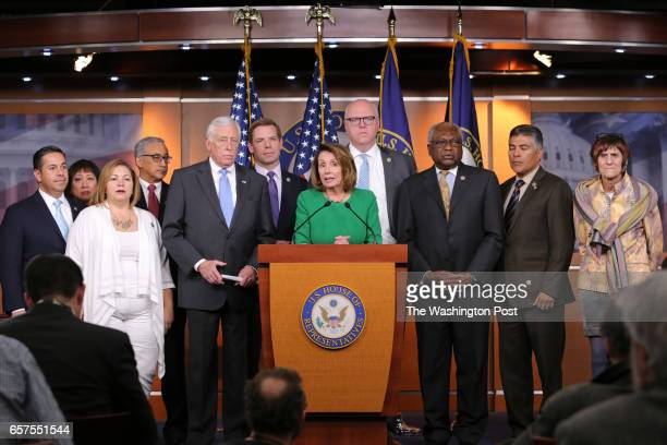 S House Minority Leader Nancy Pelosi with member House democrats hold a news conference after Republicans pulled the American Health Care Act bill to...