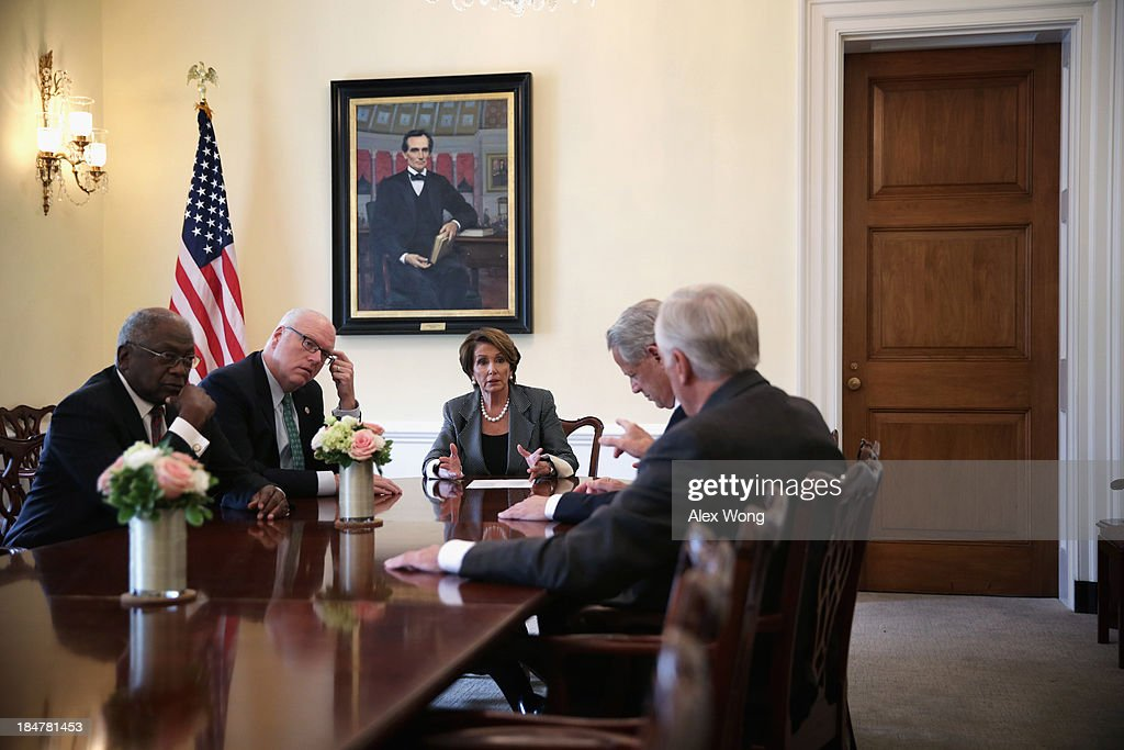 U.S. House Minority Leader Rep. Nancy Pelosi (D-CA) (3rd L) and Minority Whip Rep. Steny Hoyer (D-MD) (R) discuss as Vice Chair of the House Democratic Caucus Rep. Joseph Crowley (D-NY) (2nd L), Democratic Congressional Campaign Committee Chairman Rep. Steve Israel (D-NY) (2nd R), and Assistant House Minority Leader Rep. James Clyburn (D-SC) (L) listen during a House Democratic leadership meeting October 16, 2013 on Capitol Hill in Washington, DC. On the sixteenth day of a government shutdown, Senate Majority Leader Sen. Harry Reid (D-NV) and Minority Leader Sen. Mitch McConnell (R-KY) announced that they have reached to an agreement to raise the nation's debt ceiling and reopen the government.