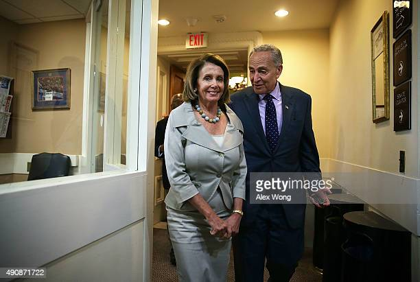 US House Minority Leader Rep Nancy Pelosi and Sen Charles Schumer arrive at a news conference October 1 2015 at the US Capitol in Washington DC...