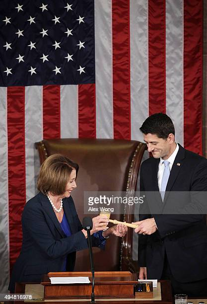 S House Minority Leader Rep Nancy Pelosi hands a gavel to incoming Speaker of the House Rep Paul Ryan in the House Chamber of the Capitol October 29...