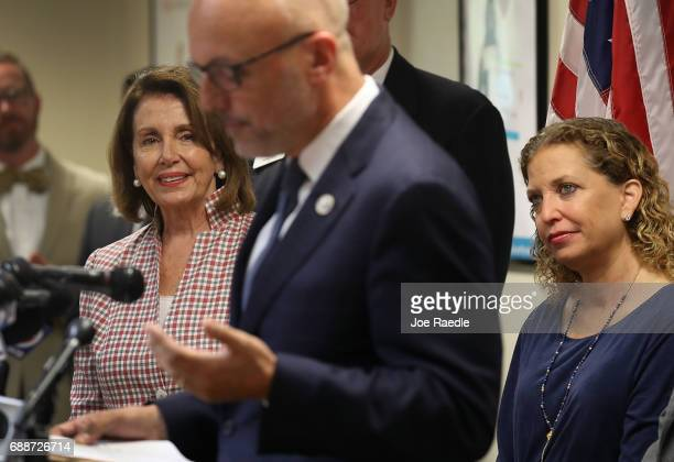 House Minority Leader Rep Nancy Pelosi Rep Debbie Wasserman Schultz listen as Rep Ted Deutch speaks as they attend a discussion about LGBT rights at...