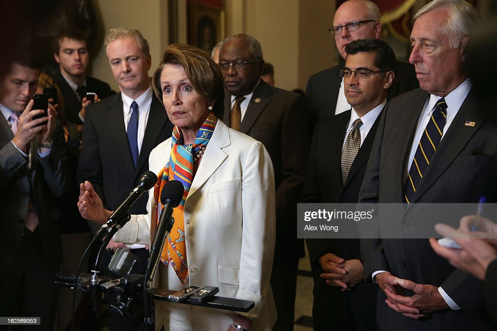 U.S. House Minority Leader Rep. <a gi-track='captionPersonalityLinkClicked' href=/galleries/search?phrase=Nancy+Pelosi&family=editorial&specificpeople=169883 ng-click='$event.stopPropagation()'>Nancy Pelosi</a> (D-CA) speaks as (L-R) Rep. Chris Van Hollen (D-MD), Assistant House Minority Leader Rep. <a gi-track='captionPersonalityLinkClicked' href=/galleries/search?phrase=James+Clyburn&family=editorial&specificpeople=668762 ng-click='$event.stopPropagation()'>James Clyburn</a> (D-SC), House Democratic Caucus Vice Chairman Rep. Joseph Crowley (D-NY), House Democratic Caucus Chairman Rep. <a gi-track='captionPersonalityLinkClicked' href=/galleries/search?phrase=Xavier+Becerra&family=editorial&specificpeople=2369133 ng-click='$event.stopPropagation()'>Xavier Becerra</a> (D-CA), and House Minority Whip Rep. <a gi-track='captionPersonalityLinkClicked' href=/galleries/search?phrase=Steny+Hoyer&family=editorial&specificpeople=588093 ng-click='$event.stopPropagation()'>Steny Hoyer</a> (D-MD) listen during a news conference September 30, 2013 on Capitol Hill in Washington, DC. The U.S. government was officially shut down at midnight after the Senate and the House of the Representatives failed to come to an agreement to pass a federal spending bill to keep the government running.