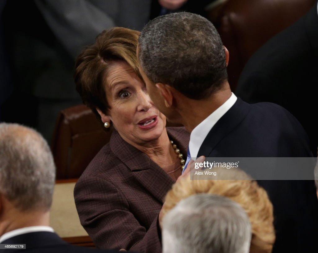 House Minority Leader Sen. <a gi-track='captionPersonalityLinkClicked' href=/galleries/search?phrase=Nancy+Pelosi&family=editorial&specificpeople=169883 ng-click='$event.stopPropagation()'>Nancy Pelosi</a> (D-CA) speaks to U.S. President <a gi-track='captionPersonalityLinkClicked' href=/galleries/search?phrase=Barack+Obama&family=editorial&specificpeople=203260 ng-click='$event.stopPropagation()'>Barack Obama</a> after he delivered the State of the Union address to a joint session of Congress in the House Chamber at the U.S. Capitol on January 28, 2014 in Washington, DC. In his fifth State of the Union address, Obama is expected to emphasize on healthcare, economic fairness and new initiatives designed to stimulate the U.S. economy with bipartisan cooperation.