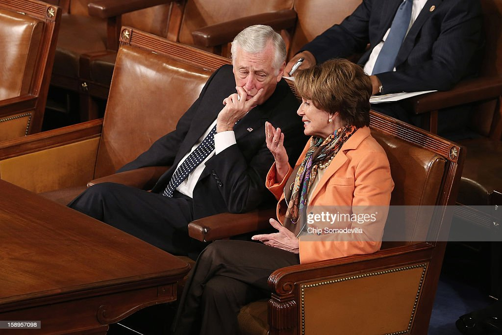 House Minority Whip <a gi-track='captionPersonalityLinkClicked' href=/galleries/search?phrase=Steny+Hoyer&family=editorial&specificpeople=588093 ng-click='$event.stopPropagation()'>Steny Hoyer</a> (D-MD) (L) and House Minority Leader <a gi-track='captionPersonalityLinkClicked' href=/galleries/search?phrase=Nancy+Pelosi&family=editorial&specificpeople=169883 ng-click='$event.stopPropagation()'>Nancy Pelosi</a> (D-CA) talk as the votes of the Electorial College from the 50 states are tallied in the House of Representatives chamber at the U.S. Capitol January 4, 2013 in Washington, DC. The votes were tallied during a joint session of the 113th Congress. President Barack Obama and Vice President Joe Biden received 332 votes to be reelected.