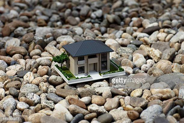 house model in the ground