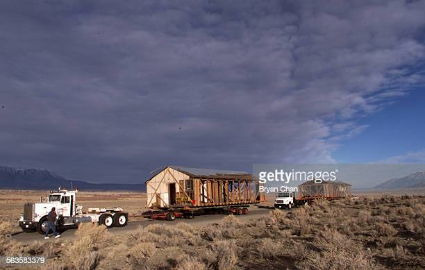 House movers pause along Eastside Road outside of Bishop for an expected CHP inspection The movers were transporting 2 sections of a mess hall back...