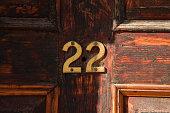 House number 22 on the wooden door