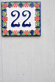 house number 22 on wall concrete