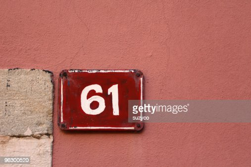 house number No 61 on pink facade : Stock Photo