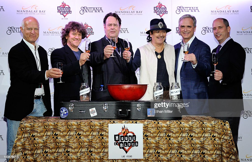 House of Blues CEO Ron Bension, promoter and co-founder of the original Woodstock Music & Art Fair Michael Lang, actor and House of Blues co-founder Dan Aykroyd, recording artist Carlos Santana, President and Chief Operating Officer of Mandalay Bay Chuck Bowling and CEO of Casa Noble Tequila Jose 'Pepe' Hermosillo share a toast at the House of Blues inside the Mandalay Bay Resort & Casino during a mud ceremony May 4, 2012 in Las Vegas, Nevada. The ceremony involved combining dirt from the town of Clarksdale in the Mississippi Delta with dirt from Bethel, New York from the site of the Woodstock Festival and mud from Santana's hometown of Autlan de Navarro, Jalisco in Mexico to symbolize his two-year residency at the music venue.