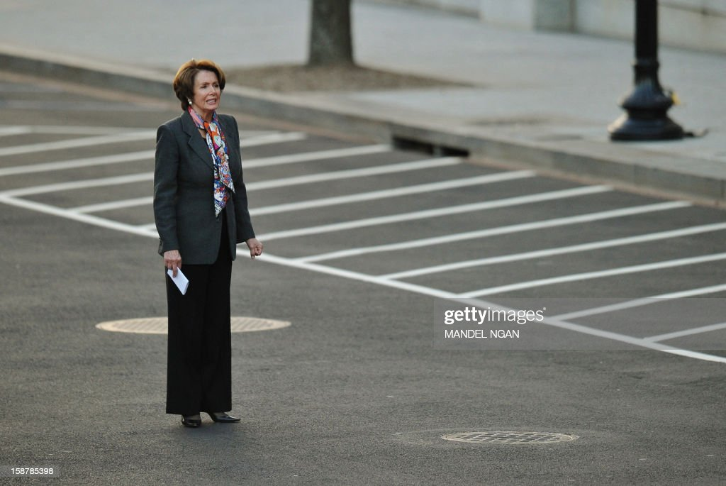 US House of Representatives Minority Leader Nancy Pelosi waits for her car as she departs from the West Wing of the White House following a meeting with US President Barack Obama on December 28, 2012 in Washington, DC. Obama met with congressional leaders for talks aimed at avoiding the 'fiscal cliff.' AFP PHOTO/Mandel NGAN