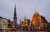 Photo of two famous buildings in Riga, Latvia: the House of the Blackheads and the St. Peter's Church