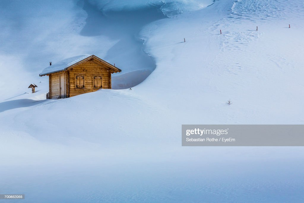House On Snow Covered Landscape