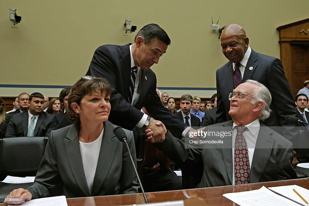House Oversight and Government Reform Committee Chairman <a gi-track='captionPersonalityLinkClicked' href=/galleries/search?phrase=Darrell+Issa&family=editorial&specificpeople=2263419 ng-click='$event.stopPropagation()'>Darrell Issa</a> (R-CA) (2nd L) and ranking member Rep. <a gi-track='captionPersonalityLinkClicked' href=/galleries/search?phrase=Elijah+Cummings&family=editorial&specificpeople=725911 ng-click='$event.stopPropagation()'>Elijah Cummings</a> (D-MD) greet Internal Revenue Service Tax Exempt and Government Entities Division revenue agent Elizabeth Hofacre (L) and retired IRS tax law specialist Carter Hull ahead of their testimony before the committee in the Rayburn House Office Building on Capitol Hill July 18, 2013 in Washington, DC. The witnesses testified as part of the committee's ongoing investigation into claims that the IRS systematically delayed and scrutinized applications for tax exempt status from organizations with the words 'Tea Party' and 'patriot' in their names.