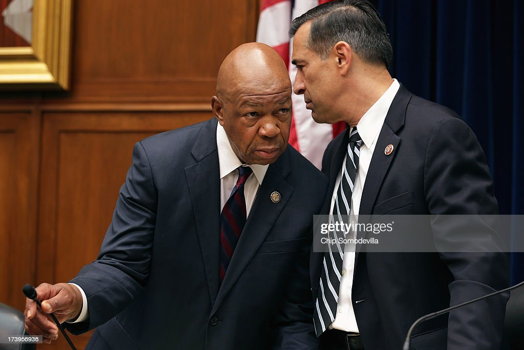 House Oversight and Government Reform Committee Chairman <a gi-track='captionPersonalityLinkClicked' href=/galleries/search?phrase=Darrell+Issa&family=editorial&specificpeople=2263419 ng-click='$event.stopPropagation()'>Darrell Issa</a> (R-CA) (R) and ranking member Rep. <a gi-track='captionPersonalityLinkClicked' href=/galleries/search?phrase=Elijah+Cummings&family=editorial&specificpeople=725911 ng-click='$event.stopPropagation()'>Elijah Cummings</a> (D-MD) confer before hearing testimony from current and former Internal Revenue Service Tax Exempt and Government Entities Division employees in the Rayburn House Office Building on Capitol Hill July 18, 2013 in Washington, DC. The witnesses testified as part of the committee's ongoing investigation into claims that the IRS systematically delayed and scrutinized applications for tax exempt status from organizations with the words 'Tea Party' and 'patriot' in their names.