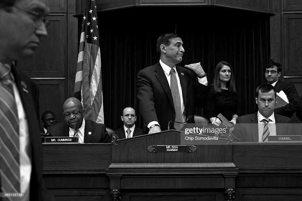 House Oversight and Government Reform Committee Chairman <a gi-track='captionPersonalityLinkClicked' href=/galleries/search?phrase=Darrell+Issa&family=editorial&specificpeople=2263419 ng-click='$event.stopPropagation()'>Darrell Issa</a> (R-CA) (C) orders ranking member Rep. <a gi-track='captionPersonalityLinkClicked' href=/galleries/search?phrase=Elijah+Cummings&family=editorial&specificpeople=725911 ng-click='$event.stopPropagation()'>Elijah Cummings</a>' (D-MD) microphone turned off after adjourning a hearing in the Rayburn House Office Building March 5, 2014 in Washington, DC. Issa adjuourned after the witness, former Internal Revenue Service official Lois Lerner, exercised her Fifth Amendment right not to speak about the matter during the hearing.