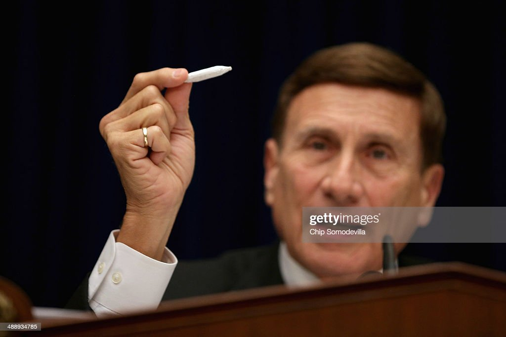 House Oversight and Government Reform Subcommittee on Government Operations Chairman John Mica (R-FL) holds a fake hand-rolled cigarette during a hearing about marijuana laws in the Rayburn House Office Building May 9, 2014 in Washington, DC. Mica said the 'joint' was rolled by members of his staff, who he said had more experience in the task. Witnesses testified about the federal government's enforcement of marijuana laws in the face of the district's efforts to decriminalize possession of the drug.
