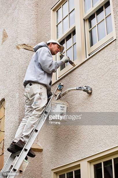 House Painter on Ladder Painting Exterior Window Trim Vt