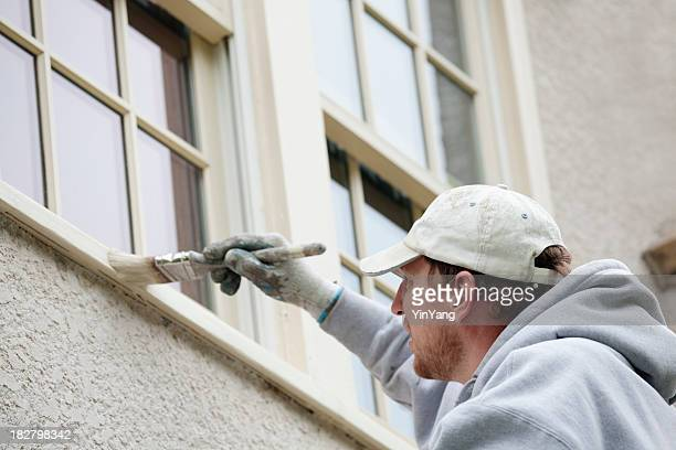 House Painter Painting and Repairing Exterior and Window of Home