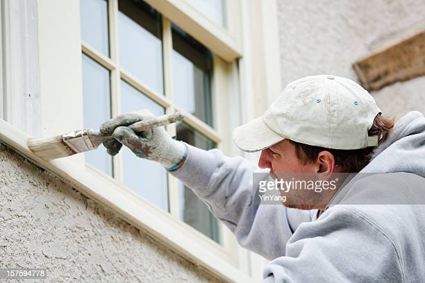 House Painter Repairman Painting Window for Home Improvement and Repair