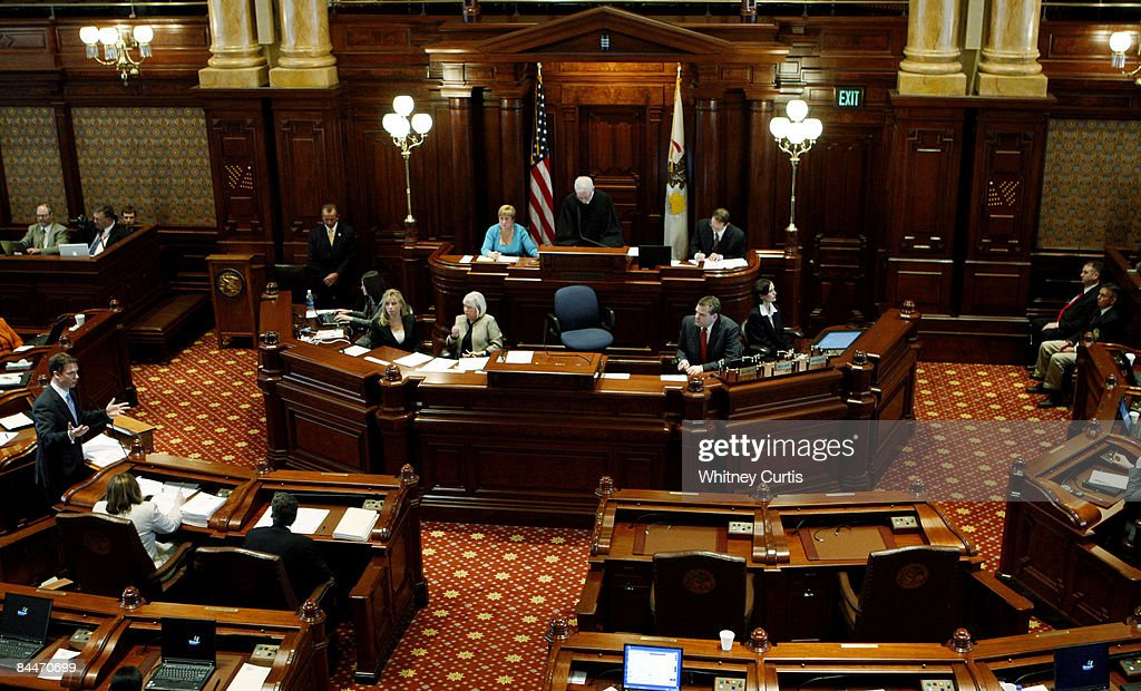 House Prosecutor David Ellis speaks during the impeachment trial for Illinois Gov Rod Blagojevich as two seats at the defense table sit empty January...