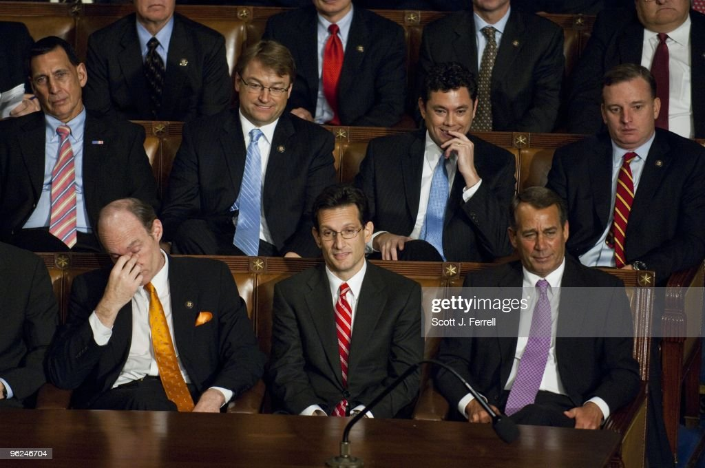 House Republican Policy Committee Chairman Thaddeus McCotter, R-Mich., House Minority Whip Eric Cantor, R-Va., and House Minority Leader John A. Boehner, R-Ohio, and other Republicans as President Barack Obama delivers his first State of the Union address to a joint session of the U.S. Congress.