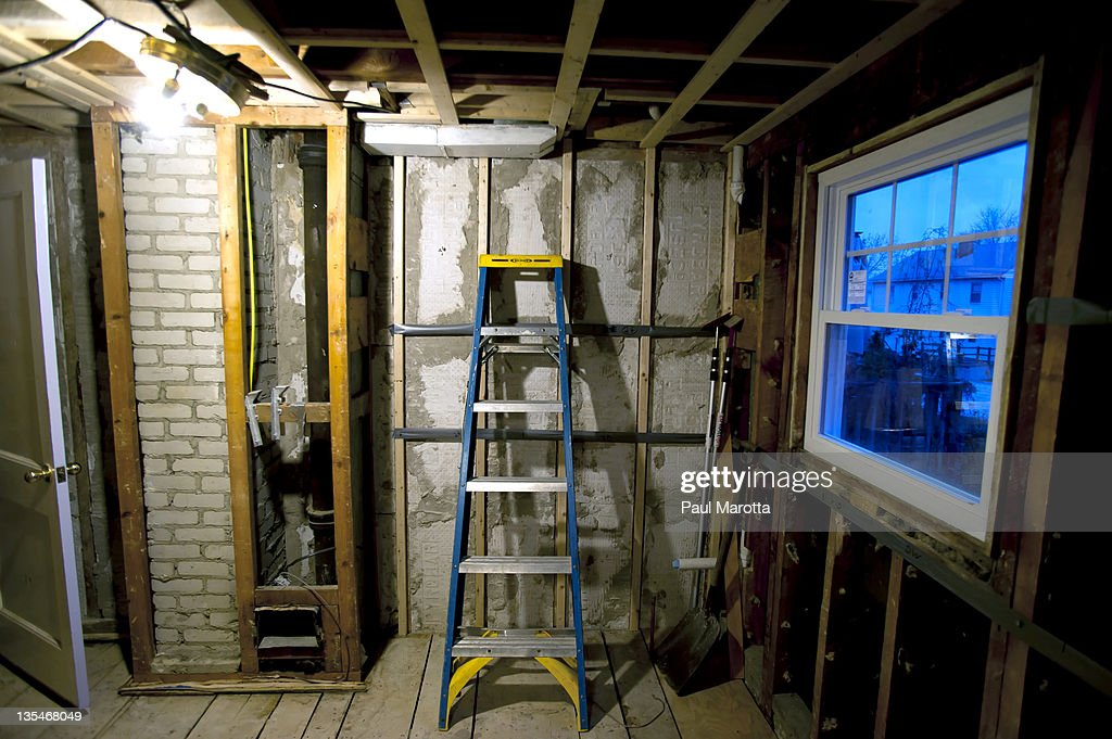 House restoration gutted kitchen with ladder : Stock Photo