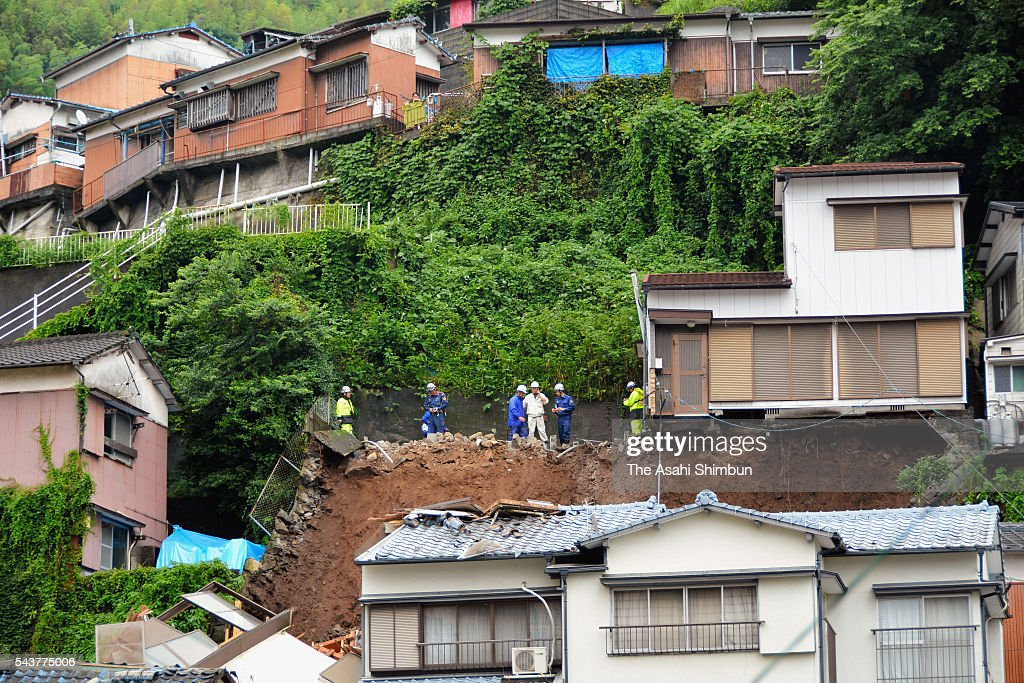 A house rolled off the cliff afte rits doundation was swept away by a landslide on June 30, 2016 in Nagasaki, Japan. Heavy rain hit Kyushu for four days.