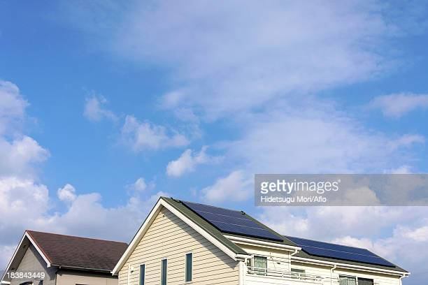 House rooftop with solar panels