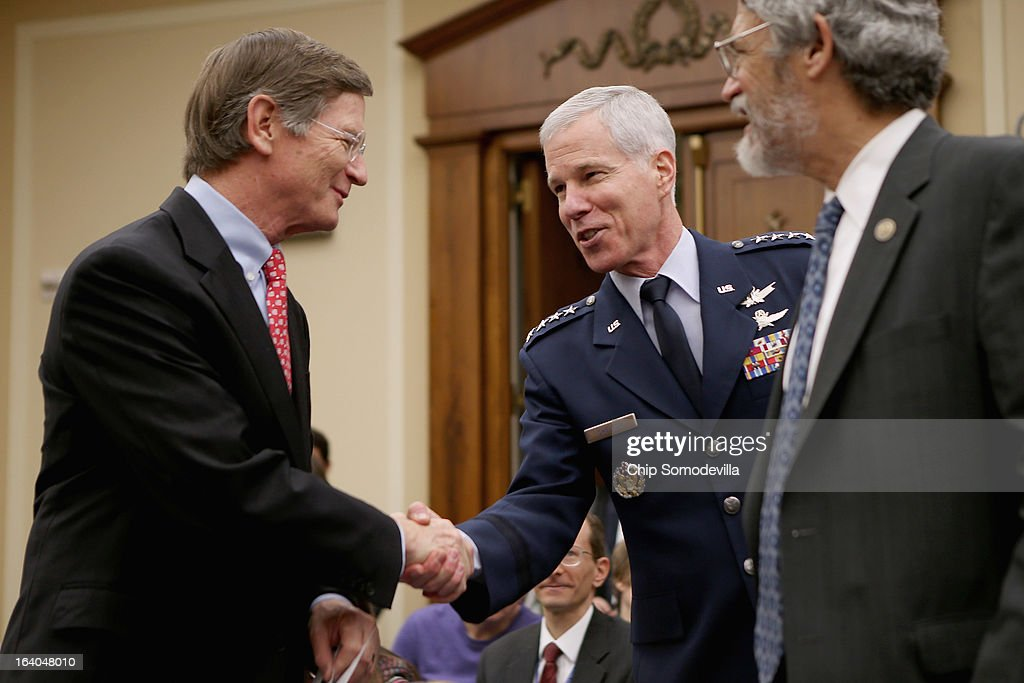 House Science, Space and Technology Committee Chairman Lamar Smith (R-TX) greets Gen. William Shelton, head of the U.S. Air Force Space Command, and White House Office of Science and Technology Policy Director John Holdren before a hearing in the Rayburn House Office Building on Capitol Hill March 19, 2013 in Washington, DC. The committee asked government and military experts about efforts to track and mitigate asteroids, meteors and other 'near-Earth objects.'