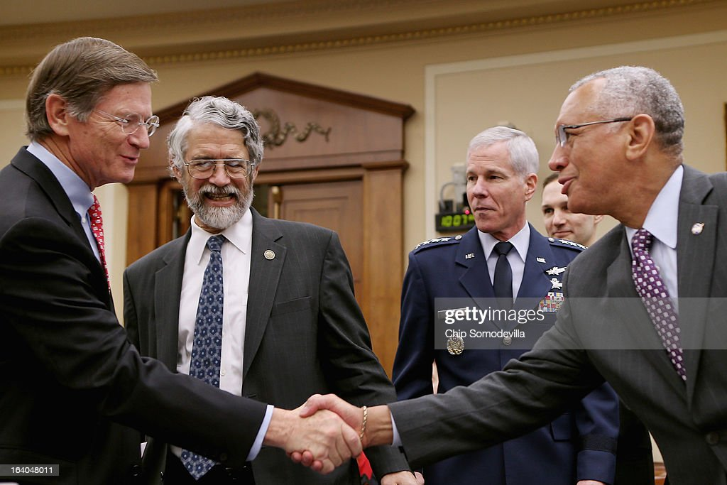 House Science, Space and Technology Committee Chairman Lamar Smith (R-TX) greets White House Office of Science and Technology Policy Director John Holdren; Gen. William Shelton, head of the U.S. Air Force Space Command; and NASA Administrator Charles Bolden Jr. before a hearing in the Rayburn House Office Building on Capitol Hill March 19, 2013 in Washington, DC. The committee asked government and military experts about efforts to track and mitigate asteroids, meteors and other 'near-Earth objects.'