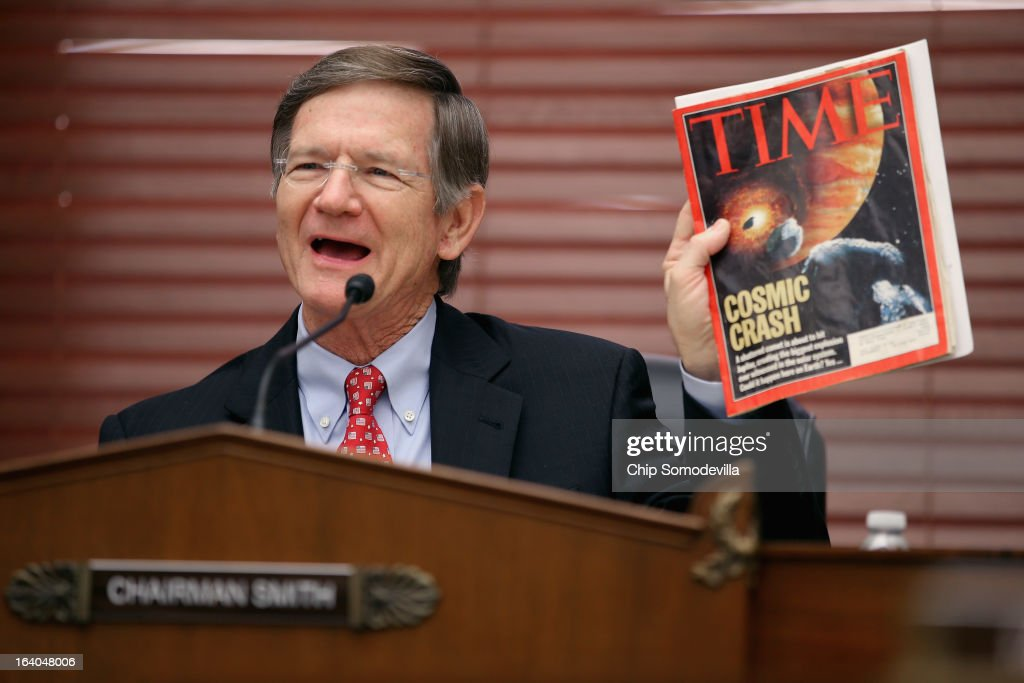 House Science, Space and Technology Committee Chairman Lamar Smith (R-TX) holds up a copy of TIME Magazine with a cover article about 'near-Earth objects' during a hearing in the Rayburn House Office Building on Capitol Hill March 19, 2013 in Washington, DC. The committee asked government and military experts about efforts to track and mitigate asteroids and meteors.