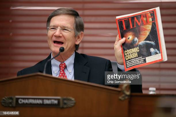 House Science Space and Technology Committee Chairman Lamar Smith holds up a copy of TIME Magazine with a cover article about 'nearEarth objects'...