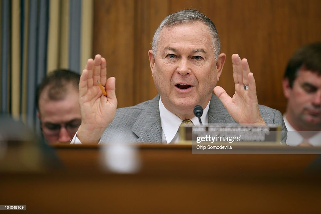 House Science, Space and Technology Committee member Rep. <a gi-track='captionPersonalityLinkClicked' href=/galleries/search?phrase=Dana+Rohrabacher&family=editorial&specificpeople=2337249 ng-click='$event.stopPropagation()'>Dana Rohrabacher</a> (R-CA) questions witnesses from NASA, the Department of Defense and the White House during a hearing in the Rayburn House Office Building on Capitol Hill March 19, 2013 in Washington, DC. The committee asked government and military experts about efforts to track and mitigate asteroids, meteors and other 'near-Earth objects.'