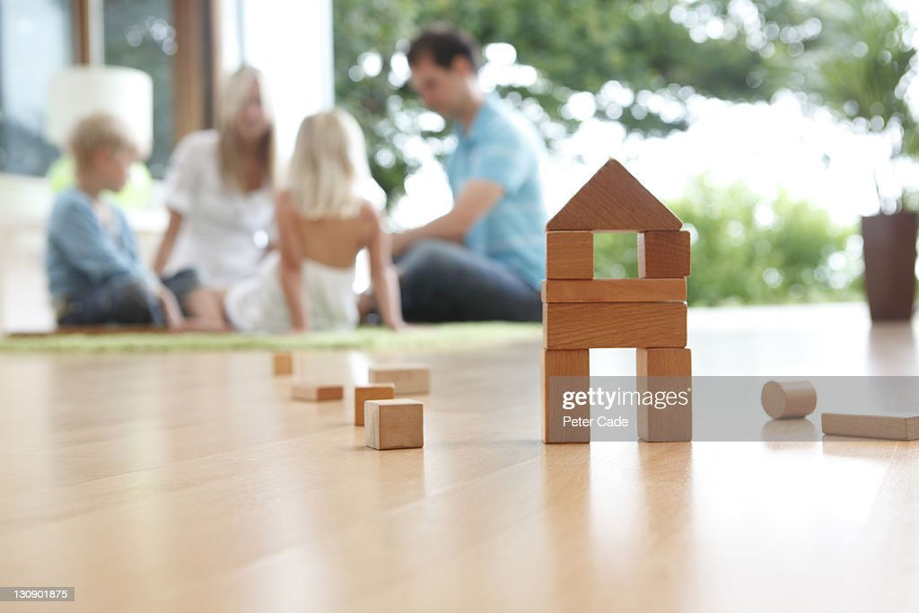 house shaped building bricks and family : Stock Photo