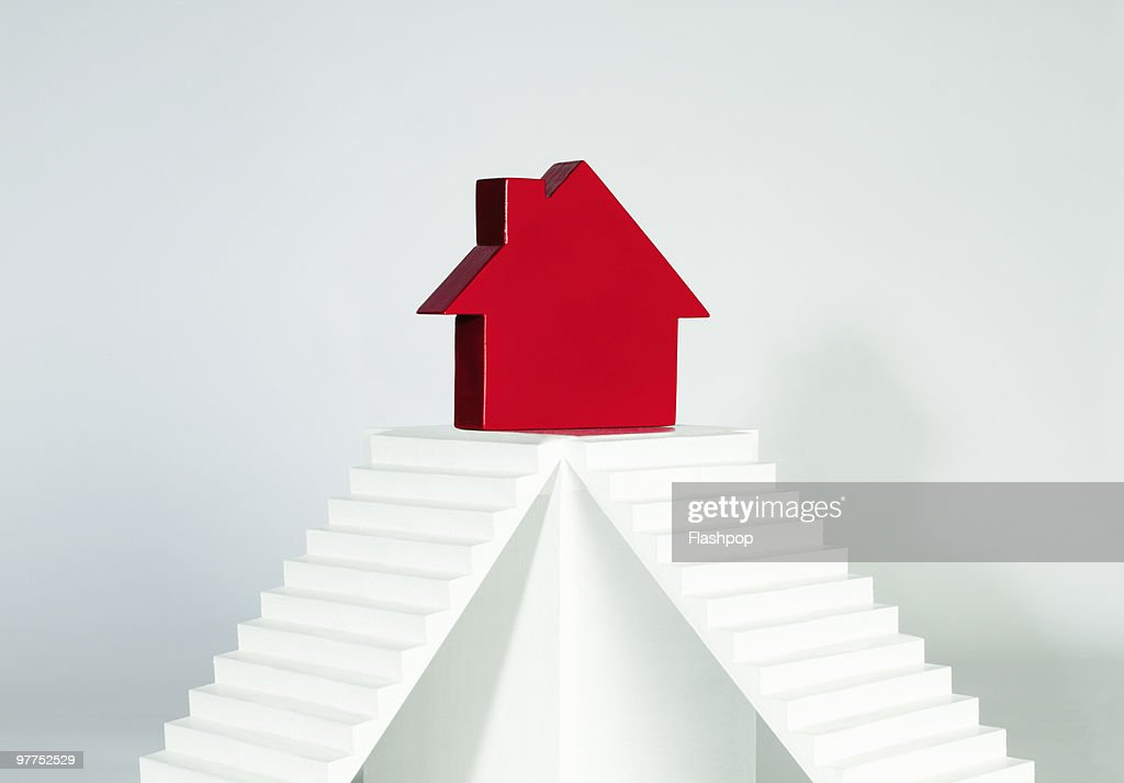 House siting on top of plinth