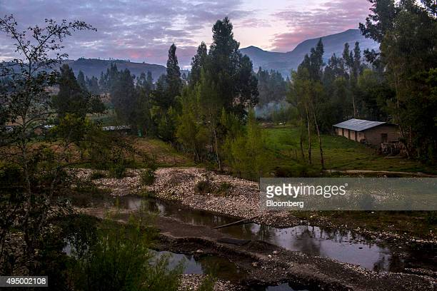 A house sits by a stream in the El Tambo village near Conga Peru on Tuesday Oct 20 2015 Local environmentalists claim the nearby Yanacocha mine...