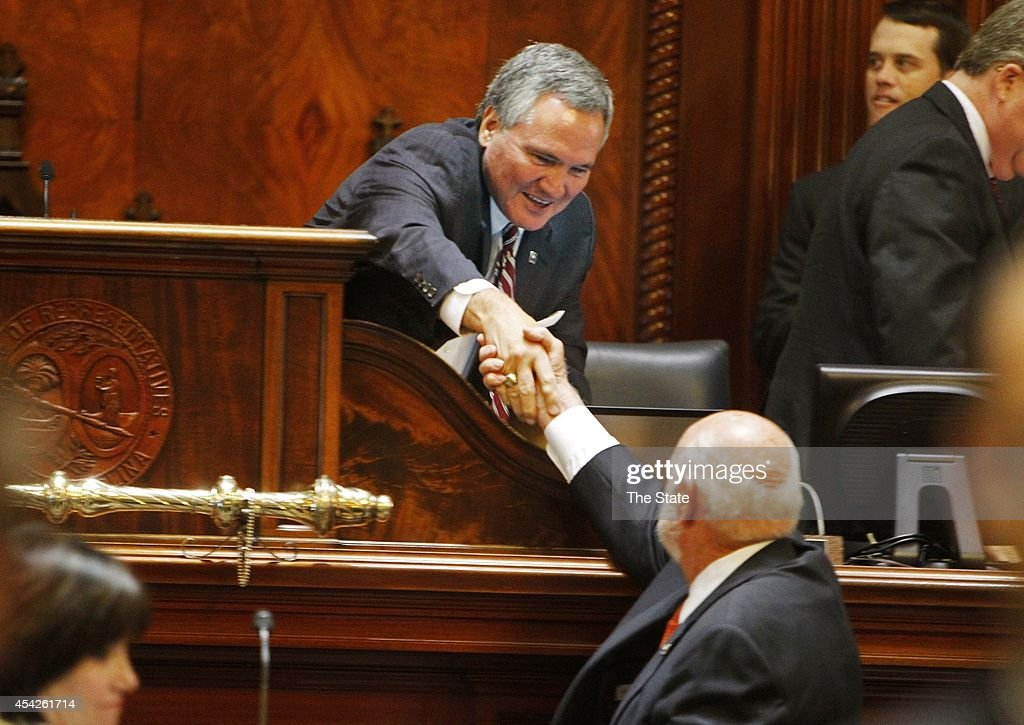 House Speaker Bobby Harrell, left, shakes hands with Rep. B.R. Skelton, R-Pickens, as the South Carolina House of Representatives adjourns after a special, one-day session, Wednesday, Aug. 27, 2014. Members decided whether to override two of Gov. Nikki Haley's vetoes left over from the session that ended in June.