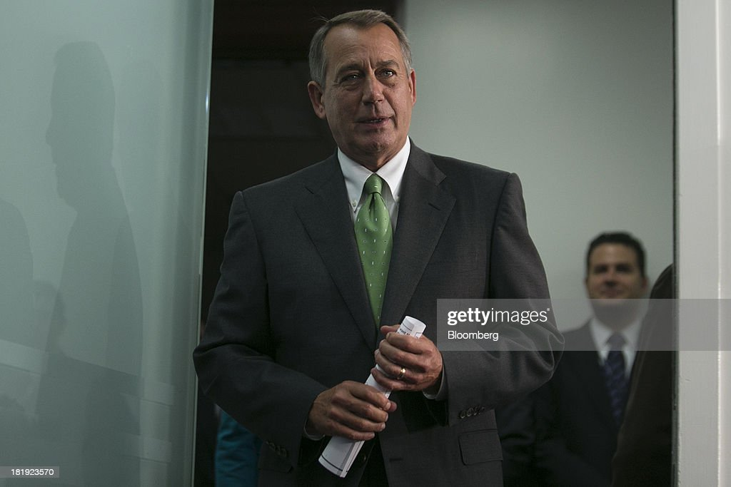House Speaker <a gi-track='captionPersonalityLinkClicked' href=/galleries/search?phrase=John+Boehner&family=editorial&specificpeople=274752 ng-click='$event.stopPropagation()'>John Boehner</a>, a Republican from Ohio, arrives to a news conference following a meeting in Washington, D.C., U.S., on Thursday, Sept. 26, 2013. Boehner's choice -- between keeping the government running and continuing to fight the nation's three-year-old health-care law - has implications for the 2014 congressional elections and, potentially, his future. Photographer: Andrew Harrer/Bloomberg via Getty Images