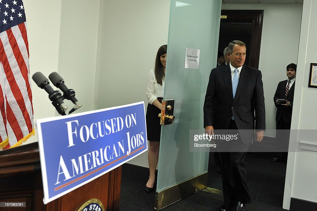 House Speaker <a gi-track='captionPersonalityLinkClicked' href=/galleries/search?phrase=John+Boehner&family=editorial&specificpeople=274752 ng-click='$event.stopPropagation()'>John Boehner</a>, a Republican from Ohio, arrives to speak before meeting with corporate leaders in McCarthy's office in Washington, D.C., U.S., on Wednesday, Nov. 28, 2012. Business executives pressing for a solution to the so-called fiscal cliff made their case at the White House and the Capitol a day after Senate Majority Leader Harry Reid lamented the lack of progress toward a deal. Photographer: Jay Mallin/Bloomberg via Getty Images