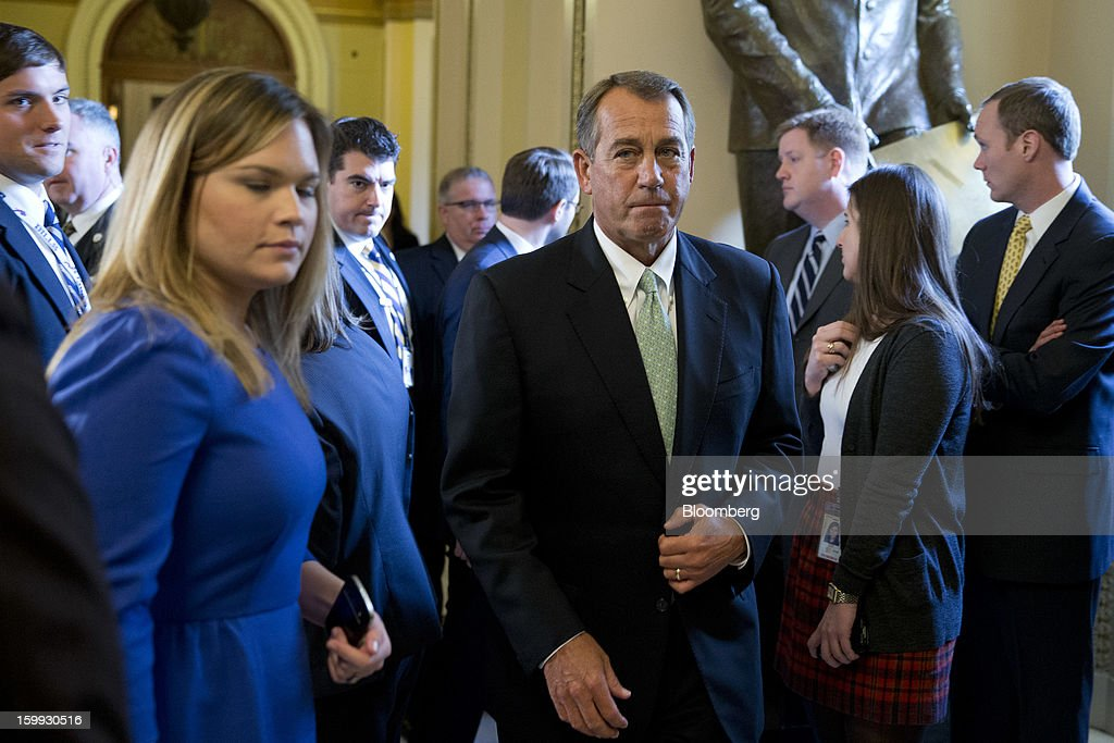 House Speaker <a gi-track='captionPersonalityLinkClicked' href=/galleries/search?phrase=John+Boehner&family=editorial&specificpeople=274752 ng-click='$event.stopPropagation()'>John Boehner</a>, a Republican from Ohio, center, leaves the floor following a vote at the U.S. Capitol in Washington, D.C., U.S., on Wednesday, Jan. 23, 2013. The U.S. House voted to temporarily suspend the nation's borrowing limit, removing the debt ceiling for now as a tool for seeking deeper spending cuts. Photographer: Andrew Harrer/Bloomberg via Getty Images