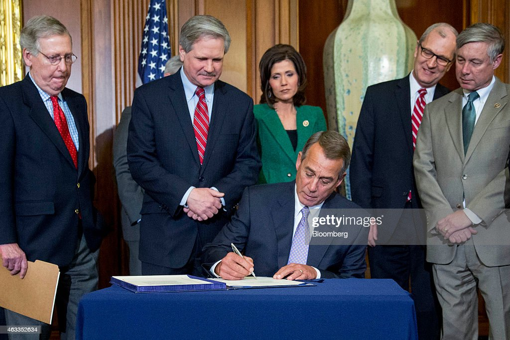 U.S. House Speaker <a gi-track='captionPersonalityLinkClicked' href=/galleries/search?phrase=John+Boehner&family=editorial&specificpeople=274752 ng-click='$event.stopPropagation()'>John Boehner</a>, a Republican from Ohio, center, signs the Keystone XL Pipeline Approval Act (S.1) during an enrollment ceremony with Senate Majority Leader <a gi-track='captionPersonalityLinkClicked' href=/galleries/search?phrase=Mitch+McConnell&family=editorial&specificpeople=217985 ng-click='$event.stopPropagation()'>Mitch McConnell</a>, a Republican from Kentucky, from left, Senator <a gi-track='captionPersonalityLinkClicked' href=/galleries/search?phrase=John+Hoeven&family=editorial&specificpeople=3082698 ng-click='$event.stopPropagation()'>John Hoeven</a>, a Republican from North Dakota, Representative Kristi Noem, a Republican from South Dakota, Representative Kevin Cramer, a Republican from North Dakota, and Representative Fred Upton, a Republican from Michigan, at the U.S. Capitol in Washington, D.C., U.S., on Friday, Feb. 13, 2015. Congressional Republicans achieved an elusive legislative goal Wednesday, sending a bill to approve the Keystone XL pipeline to President Barack Obama. The U.S. House passed the measure 270-152, with 29 Democrats joining all but one Republican to support the bill. Photographer: Andrew Harrer/Bloomberg via Getty Images