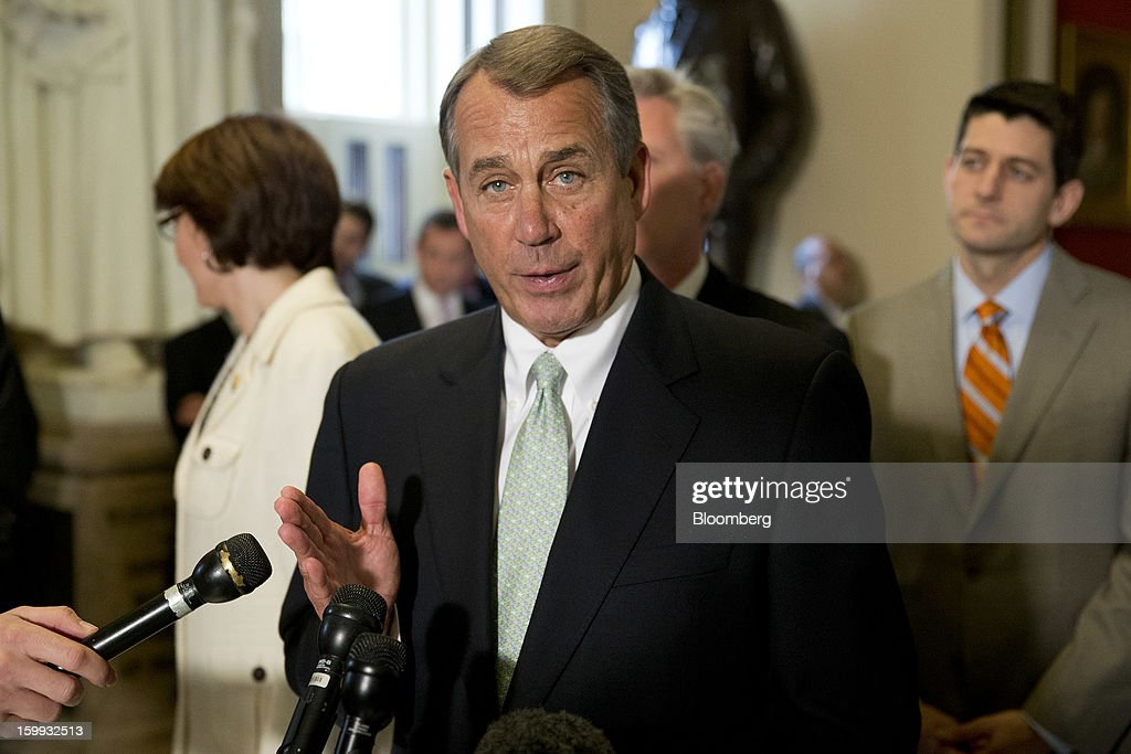 House Speaker <a gi-track='captionPersonalityLinkClicked' href=/galleries/search?phrase=John+Boehner&family=editorial&specificpeople=274752 ng-click='$event.stopPropagation()'>John Boehner</a>, a Republican from Ohio, center, speaks following a vote with Representative Paul Ryan, a Republican from Wisconsin, right, at the U.S. Capitol in Washington, D.C., U.S., on Wednesday, Jan. 23, 2013. The U.S. House voted to temporarily suspend the nation's borrowing limit, removing the debt ceiling for now as a tool for seeking deeper spending cuts. Photographer: Andrew Harrer/Bloomberg via Getty Images