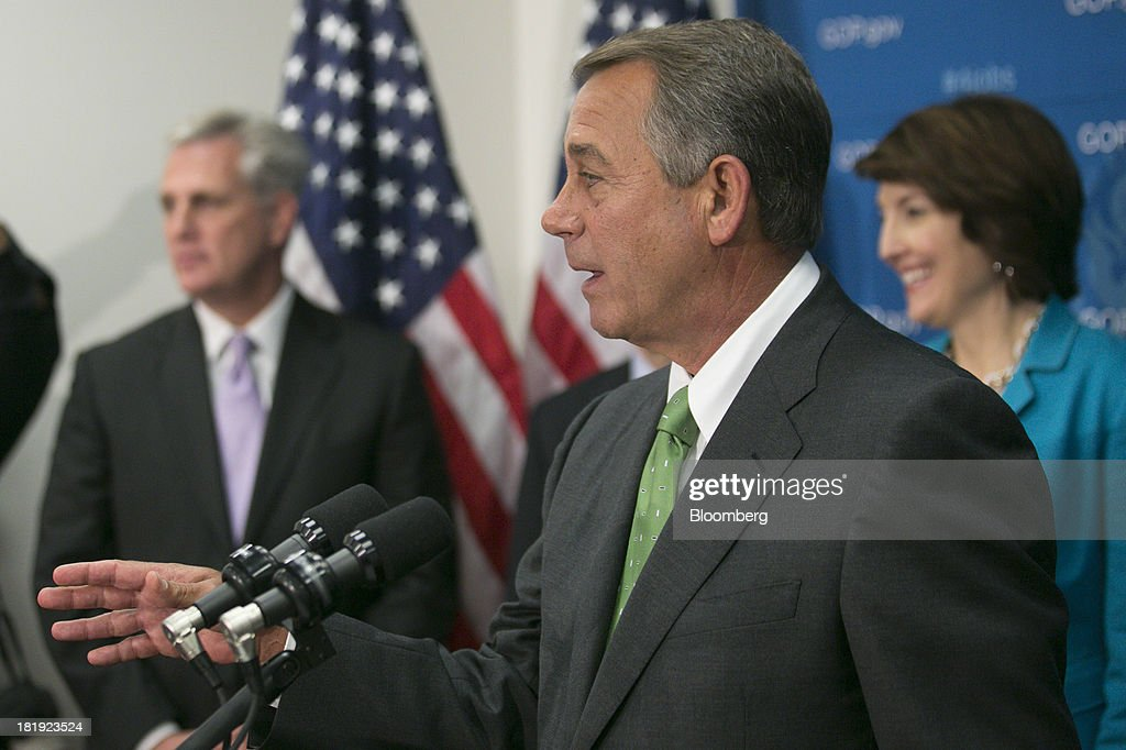 House Speaker <a gi-track='captionPersonalityLinkClicked' href=/galleries/search?phrase=John+Boehner&family=editorial&specificpeople=274752 ng-click='$event.stopPropagation()'>John Boehner</a>, a Republican from Ohio, center, speaks during a news conference with Majority Whip Kevin McCarthy, a Republican from California, left, and Representative Cathy McMorris Rodgers, a Republican from Washington, in Washington, D.C., U.S., on Thursday, Sept. 26, 2013. Boehner's choice -- between keeping the government running and continuing to fight the nation's three-year-old health-care law - has implications for the 2014 congressional elections and, potentially, his future. Photographer: Andrew Harrer/Bloomberg via Getty Images