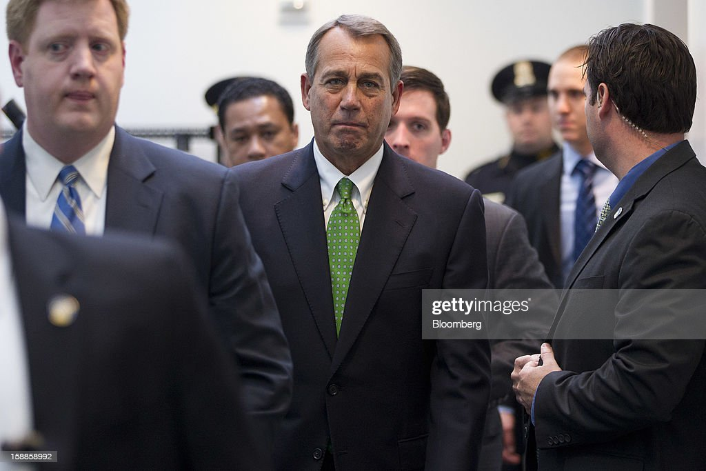 House Speaker <a gi-track='captionPersonalityLinkClicked' href=/galleries/search?phrase=John+Boehner&family=editorial&specificpeople=274752 ng-click='$event.stopPropagation()'>John Boehner</a>, a Republican from Ohio, center, walks out of a House Republican caucus meeting at the U.S. Capitol in Washington, D.C., U.S., on Tuesday, Jan. 1, 2013. The U.S. Senate passed a bipartisan budget deal two hours after income tax cuts expired, reaching an after-deadline agreement to undo the potential economic harm of $600 billion in tax increases and spending cuts. Photographer: Andrew Harrer/Bloomberg via Getty Images