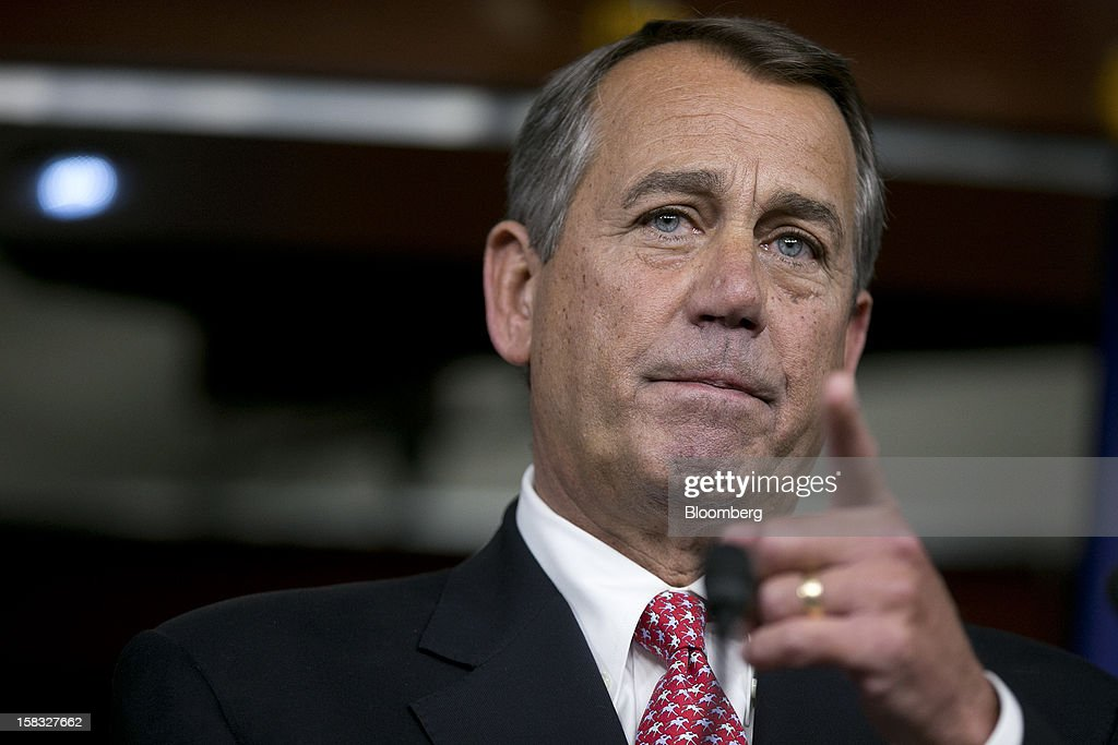 House Speaker <a gi-track='captionPersonalityLinkClicked' href=/galleries/search?phrase=John+Boehner&family=editorial&specificpeople=274752 ng-click='$event.stopPropagation()'>John Boehner</a>, a Republican from Ohio, gestures towards a reporter during a news conference in Washington, D.C., U.S., on Thursday, Dec. 13, 2012. Boehner repeated his insistence that President Barack Obama's budget proposal is 'anything but' balanced and accused the president of being 'not serious' about cutting spending. Photographer: Andrew Harrer/Bloomberg via Getty Images