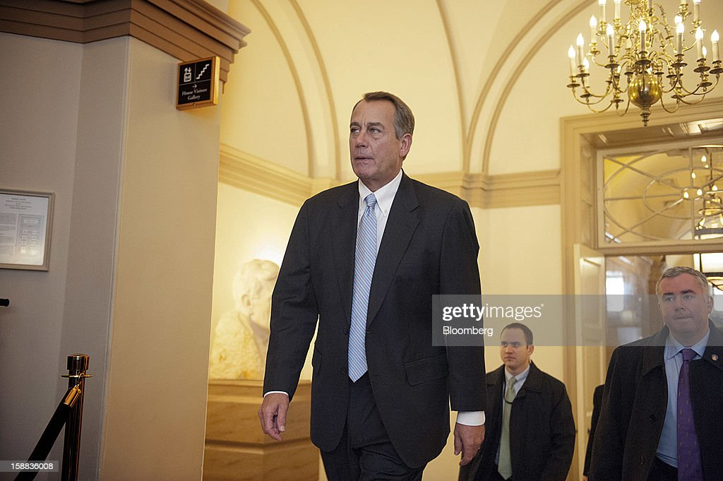 House Speaker John Boehner, a Republican from Ohio, left, arrives at the U.S. Capitol in Washington, D.C., U.S., on Monday, Dec. 31, 2012. U.S. lawmakers hurtled toward a midnight deadline to avert hundreds of billions of dollars in tax increases and spending cuts, struggling to extract the country from a fiscal trap they created. Photographer: Jay Mallin/Bloomberg via Getty Images